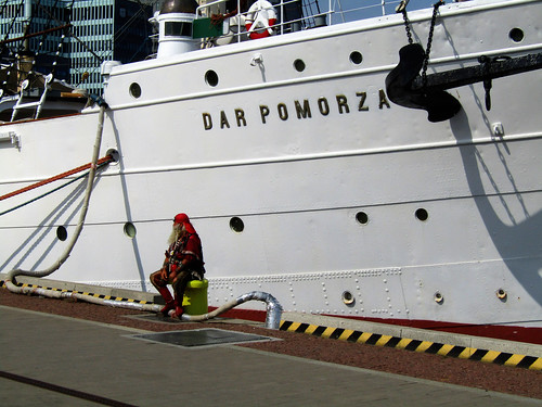 Pirate sitting next to The Dar Pomorza