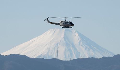 A UH-1N Iroquois with the 459th Airlift Squadron conducts a routine sortie over Yokota Air Base
