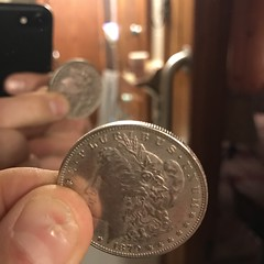 Two-Headed Morgan dollar in mirror