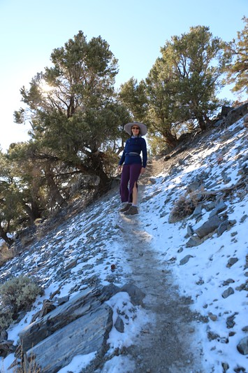 Vicki hiking on the snow-covered Telescope Peak Trail