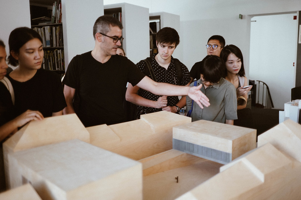 Visiting Critic Rodolfo Reis Dias explains a model to students during a studio visit in Lisbon, Portugal.  photo / Ihwa Choi (B.Arch. '20)