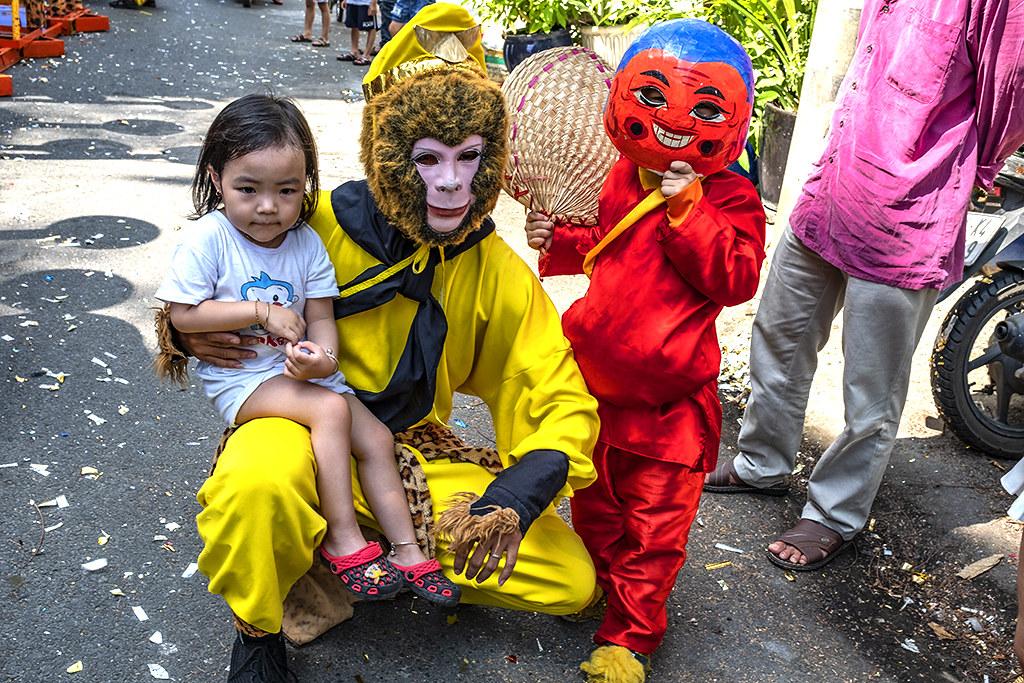 Girl posing with Monkey King--Saigon