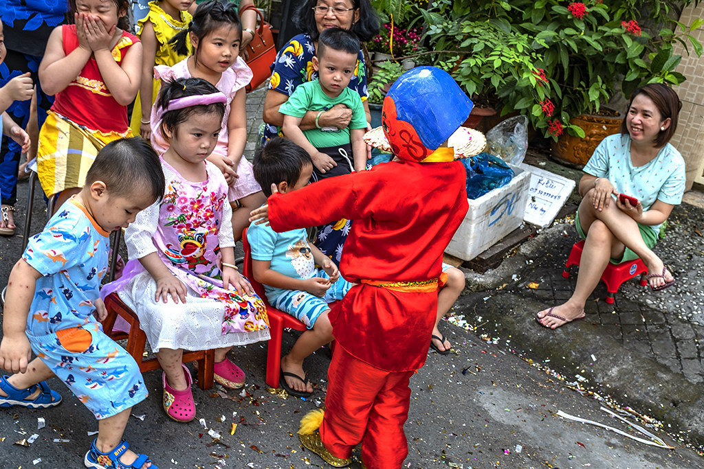 Kids watching dragon and lion dancers in a District 6 alley--Saigon 4