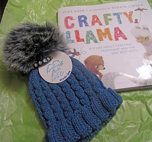 Handknit cabled hat for child by irieknit and picture book