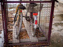 Bicycles locked up in a cage to prevent theft