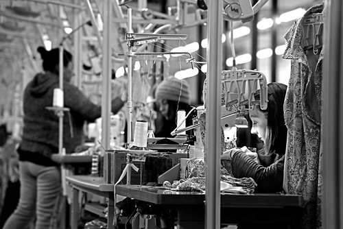A seamstress at Everest Textiles sews dresses at the Forest City plant in Rutherford County. NC State's Zeis Textiles Extension assisted in getting the Taiwanese textile company to move into the state in 2016.