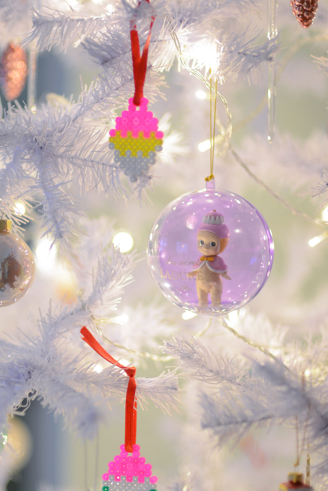 Beautiful pastel colored ornaments in a white Christmas tree