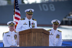 Capt. Richard Seif addresses guests during the Submarine Squadron 1 change of command ceremony as Capt. Wesley Bringham, right, and Rear Adm. Daryl Caudle look on. (U.S. Navy/MC2 Melvin J. Gonzalvo)