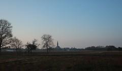 in the background the high tower of the church of Rheinbischofsheim - Photo of Herrlisheim