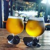 Sunny Saturday in #thetron how better to spend an hour or two in the evening #crafthamilton #craftbeer #lovethetron Image description: two glasses filled with refreshing amber nectar, lit by the evening sun wearing their shades!
