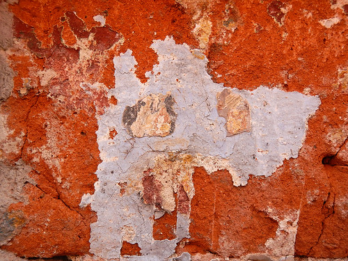 An orange wall texture in Puebla, Mexico