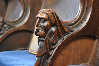 return stalls: man in a headdress holding his mouth open (15th Century)