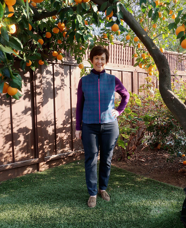plaid vest under orange tree