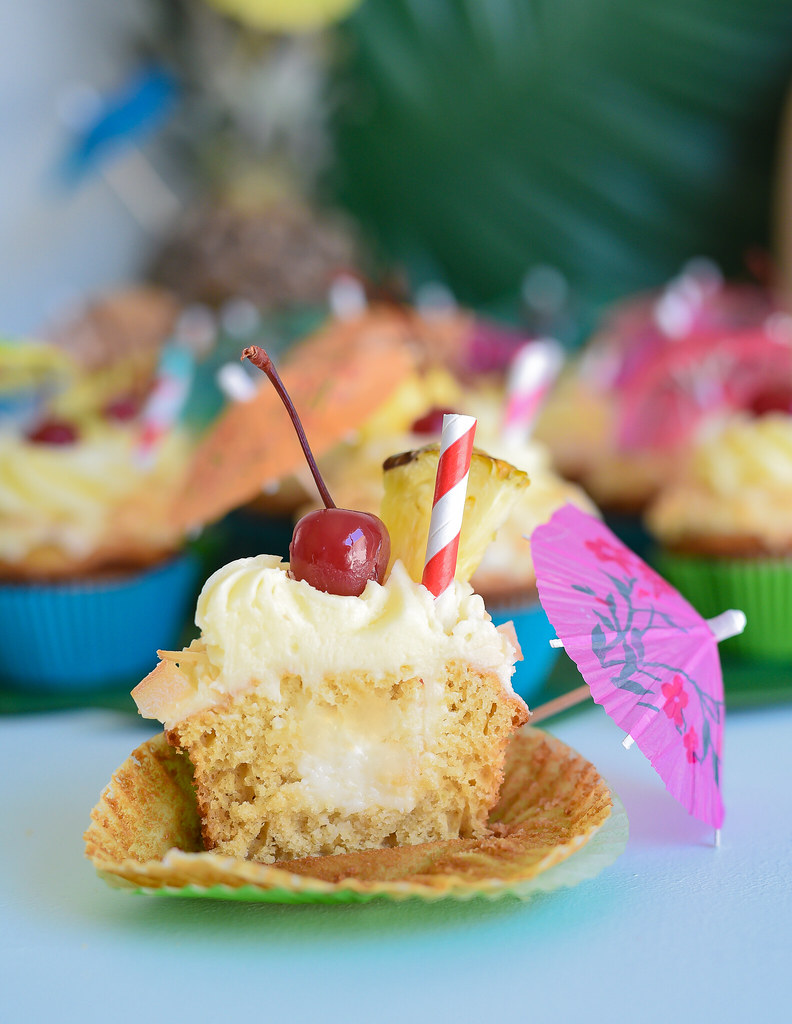 Piña Colada Cupcakes with Haupia filling and Piña Colada Frosting www.pineappleandcoconut.com