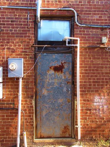 sanford northcarolina leecounty smalltownnorthcarolina smalltown alley backalley forgotten bricks door service wiring skinnydoor skinny rusty rustydoor
