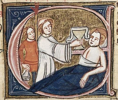 Priest clerk giving communion (1)