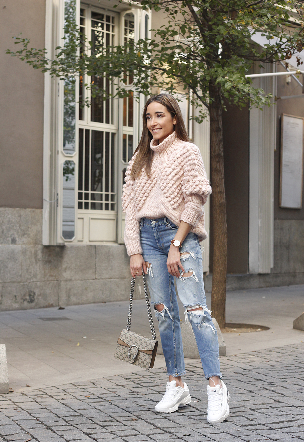 chunky pink sweater ripped jeans white fila sneakers gucci bag street style fall outfit 20184698