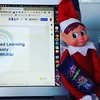 Chocolate for elves #elfantics #elfatwork Image description: elf sitting to the right of a laptop computer with a bar of chocolate