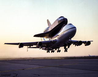 Space Shuttle Endeavour Mated to 747 SCA Takeoff for Delivery to Kennedy Space Center, Florida, 1991. Original from NASA . Digitally enhanced by rawpixel.