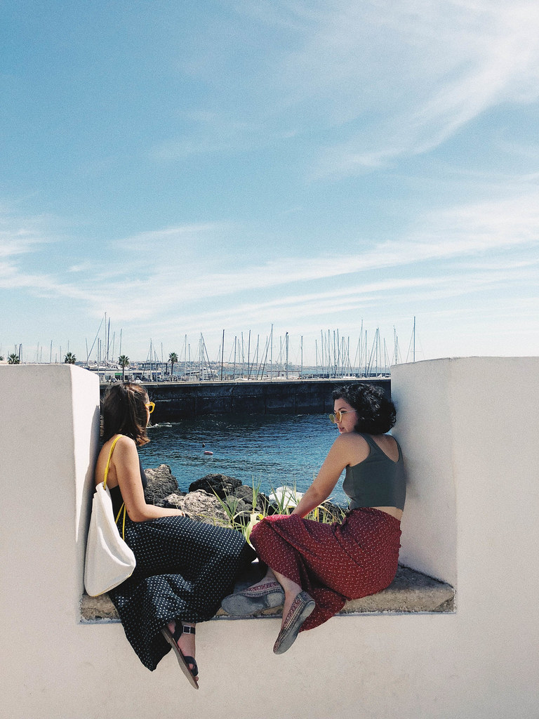 Ruth Marcotte (B.Arch. '20) and Genevieve Riedel (B.Arch. '20) sit outside the Santa Marta Lighthouse designed by Manuel Aires Mateus in Lisbon, Portugal.  photo / Ihwa Choi (B.Arch. '20)