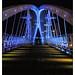 Salford Quays Lift Bridge lit-up in blue