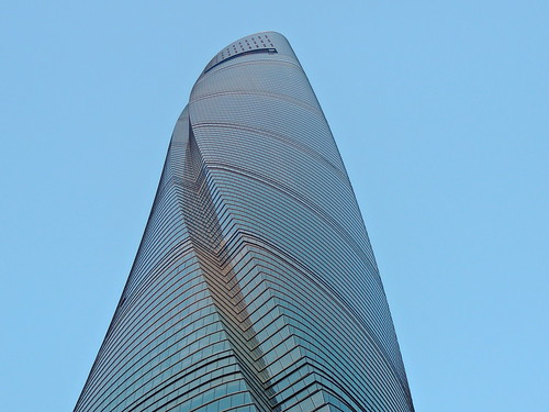 Shanghai Tower spiraling modern architecture against blue sky