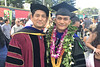 Deveraux Talagi,right, graduated on December 15, 2018 with his PhD in economics from the University of Hawaii at Manoa. Also pictured is Talagi's advisor Nori Tarui, a UH Manoa professor of economics.