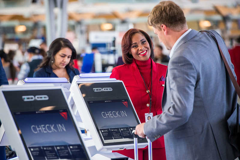 Customer greeted by Delta employee at ATL Terminal F
