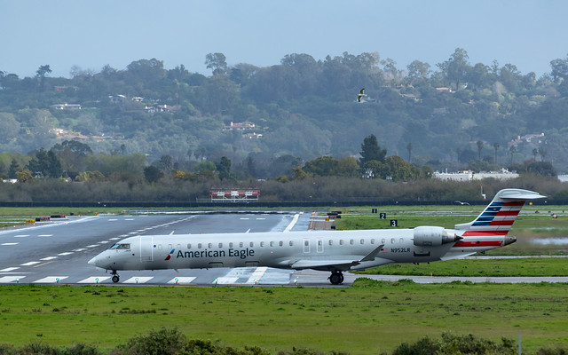 American Eagle Bambardier CRJ-900ER takes runway 7 at KSBA
