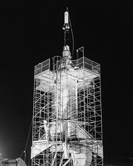 The Mercury capsule and escape tower are being lowered onto the Little Joe booster for launch on August 21, 1959. Original from NASA. Digitally enhanced by rawpixel.