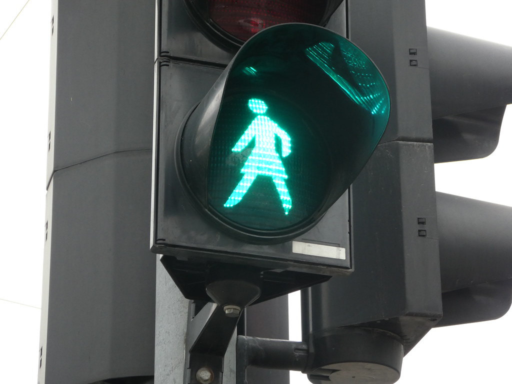 Female pedestrian traffic light crossing in Vilnius