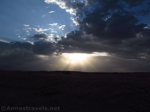 Sun through the storm clouds near the Valley of Dreams East, New Mexico