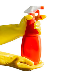 Female hands with yellow gloves holding a red spay bottle. Isolated on white background. Bottle mock up