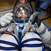 jsc2018e097297 - In the Integration Facility at the Baikonur Cosmodrome in Kazakhstan, Expedition 58 crewmember Anne McClain of NASA conducts a pressure and leak check of her Russian Sokol launch and entry suit Nov. 20. McClain, Oleg Kononenko of Roscosmo