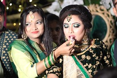 Sara feeding her sister, the bride Sadia