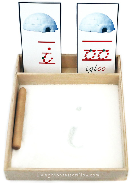 Salt Writing Tray with I for Igloo and oo Phonogram in Igloo