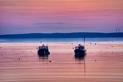 The last few fishing boats at sunrise.