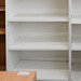 Tall white open front book case with shelves E80