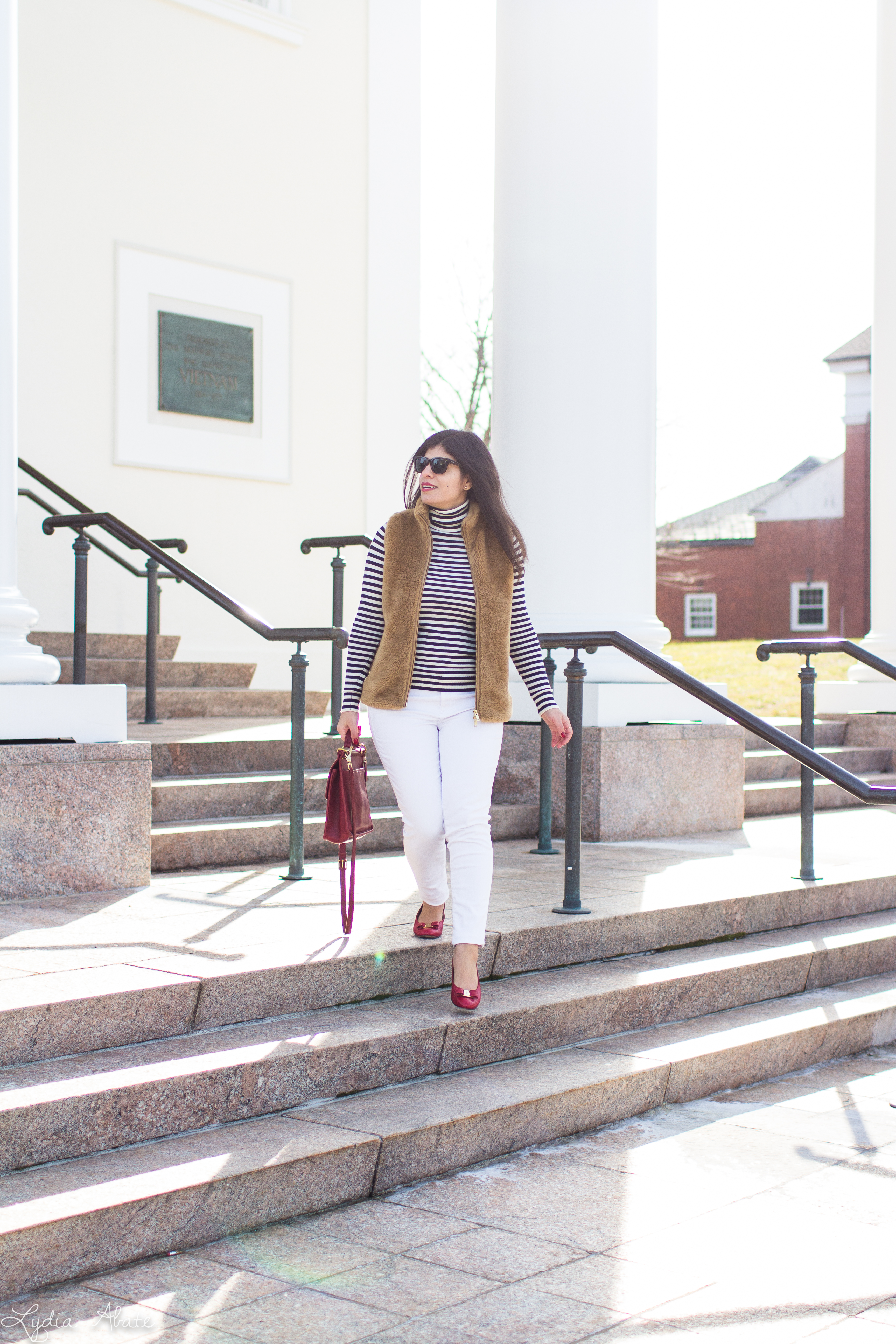 J.Crew plush excursion vest, striped shirt, white jeans, red Ferragamo bow pumps, coach bag-14.jpg