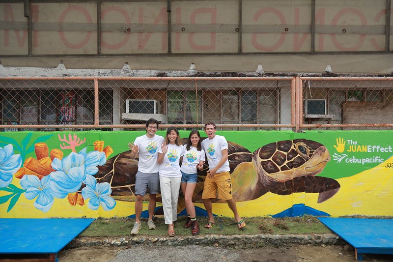 Advocates photo by the Dapa school mural