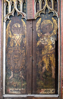 north aisle screen: angel with a shield of the Holy Trinity and St Gabriel (15th Century)