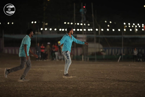 Devotees playing Cricket