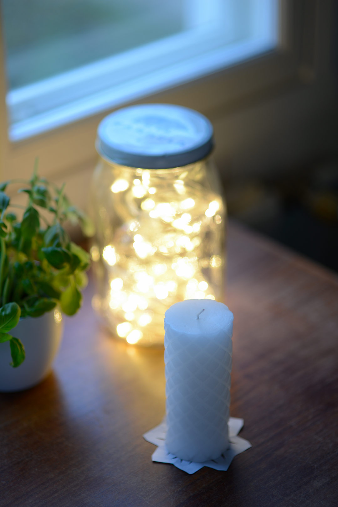 Fairy lights in a vintage glass jar