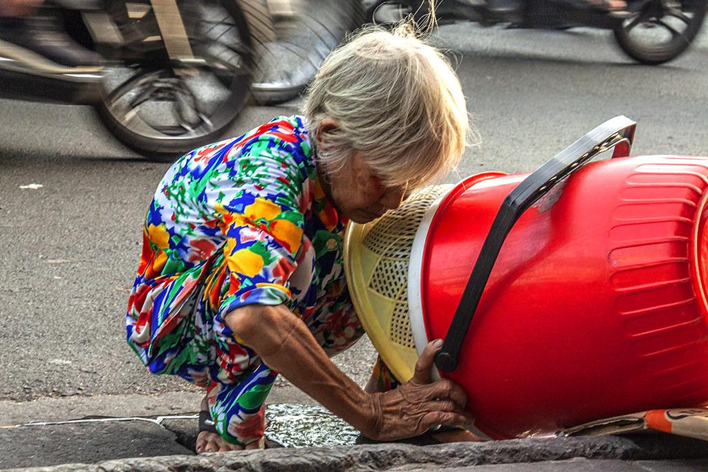 Old woman at sidewalk cafe on Cao Van Kiet--Saigon 2
