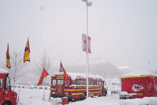 Kansas City Chiefs fans gather in the parking lot of Arrowhead Stadium in the middle of a blizzard long before kickoff at the playoff game against the Indianapolis Colts on January 12. 2019.