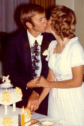 Paul and Jill Weaver kiss at wedding - 1973