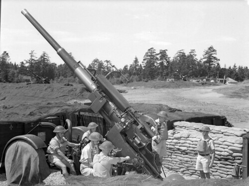 A static 3.7-inch gun's assigned to the 127th Heavy Anti-Aircraft Regiment, mounted on a Pyle platform  October 1944.