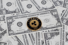 Ripple coin and dollar bills
