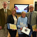 Thu, 01/03/2019 - 13:55 - The group includes, from left: Aaron Grabowski of Medina, Diane Palmer of Albion, Beryl Barnes (accepting for her son Arthur Barnes) and Roy Bubb, who has written about growing up in Clarendon.