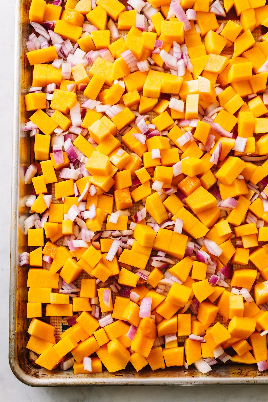 AUTUMN BUTTERNUT SQUASH QUINOA SALAD: Butternut squash and onion on sheet pan